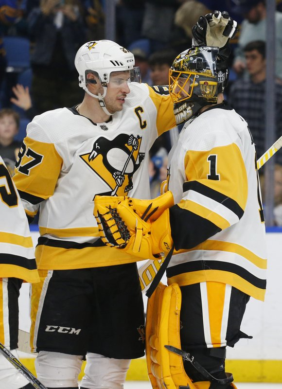 Pittsburgh Penguins Sidney Crosby (87) and Casey DeSmith (1) celebrate a 5-0 victory in the team's NHL hockey game against the Buffalo Sabres, Thursday, March 14, 2019, in Buffalo, N. (AP Photo/Jeffrey T. Barnes)