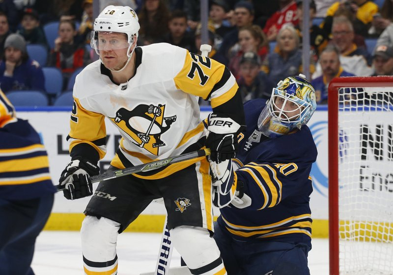 Buffalo Sabres goalie Carter Hutton (40) is screened by Pittsburgh Penguins forward Patric Hornqvist (72) during the second period of an NHL hockey game Thursday, March 14, 2019, in Buffalo, N. (AP Photo/Jeffrey T. Barnes)