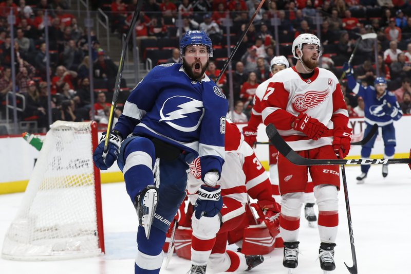 Tampa Bay Lightning's Nikita Kucherov celebrates his goal against the Detroit Red Wings in the third period of an NHL hockey game, Thursday, March 14, 2019, in Detroit. (AP Photo/Paul Sancya)