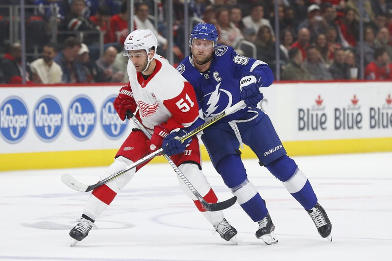 Detroit Red Wings center Frans Nielsen (51) and Tampa Bay Lightning center Steven Stamkos (91) battle for position in the first period of an NHL hockey game against the Tampa Bay Lightning, Thursday, March 14, 2019, in Detroit. (AP Photo/Paul Sancya)