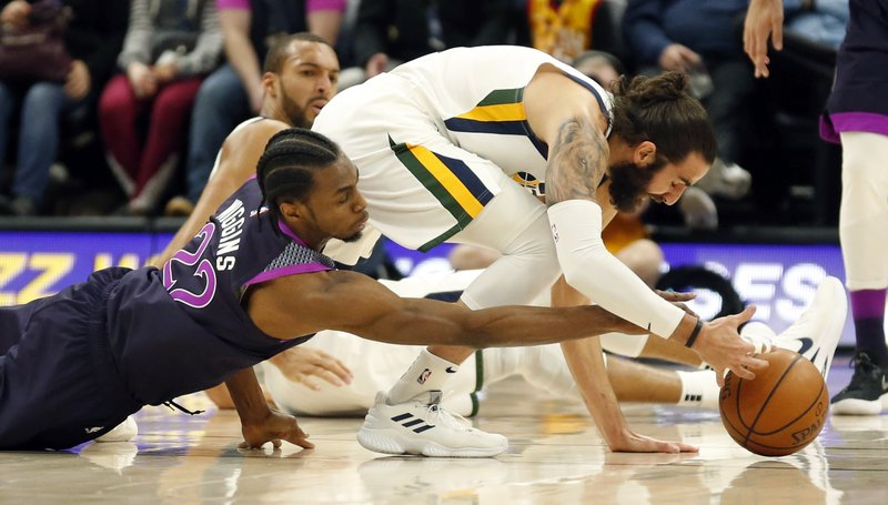 Minnesota Timberwolves forward Andrew Wiggins (22) battles with Utah Jazz guard Ricky Rubio, right, for the ball in the first half during an NBA basketball game Thursday, March 14, 2019, in Salt Lake City. (AP Photo/Rick Bowmer)