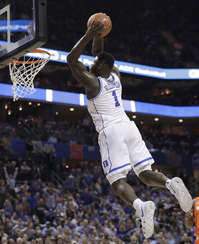 Duke's Zion Williamson (1) goes up to dunk against Syracuse during the first half of an NCAA college basketball game in the Atlantic Coast Conference tournament in Charlotte, N. (AP Photo/Nell Redmond)