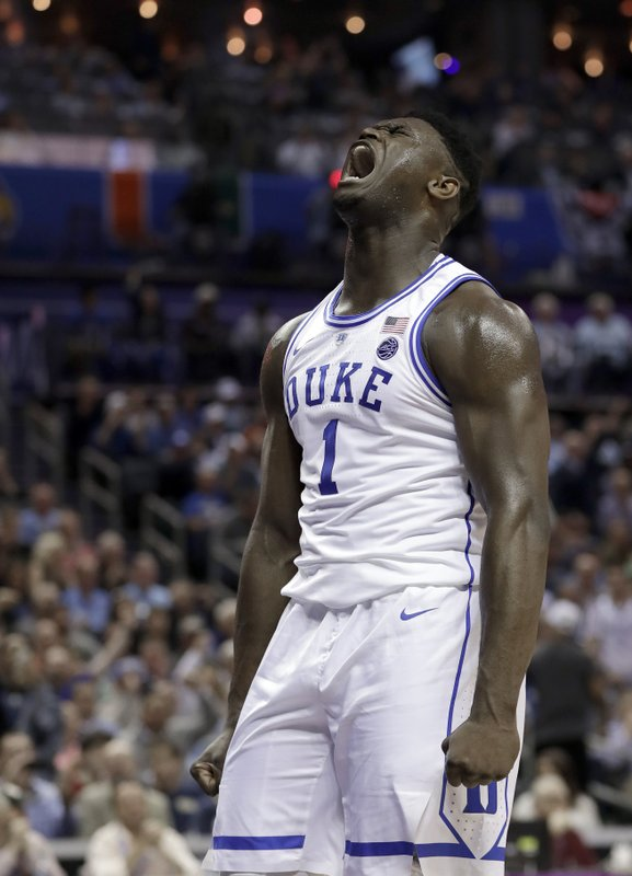 Duke's Zion Williamson (1) reacts after his basket against Syracuse during the first half of an NCAA college basketball game in the Atlantic Coast Conference tournament in Charlotte, N. (AP Photo/Nell Redmond)