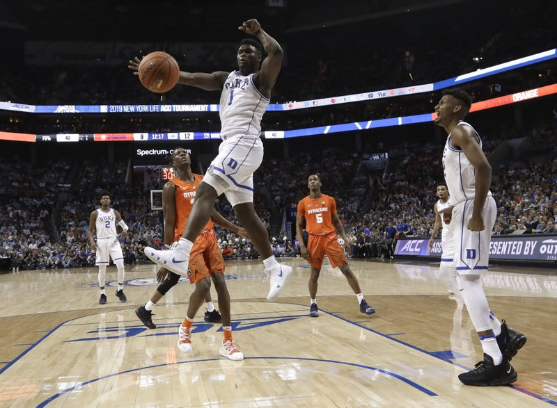 Duke's Zion Williamson (1) reacts after his dunk against Syracuse during the first half of an NCAA college basketball game in the Atlantic Coast Conference tournament in Charlotte, N. (AP Photo/Chuck Burton)