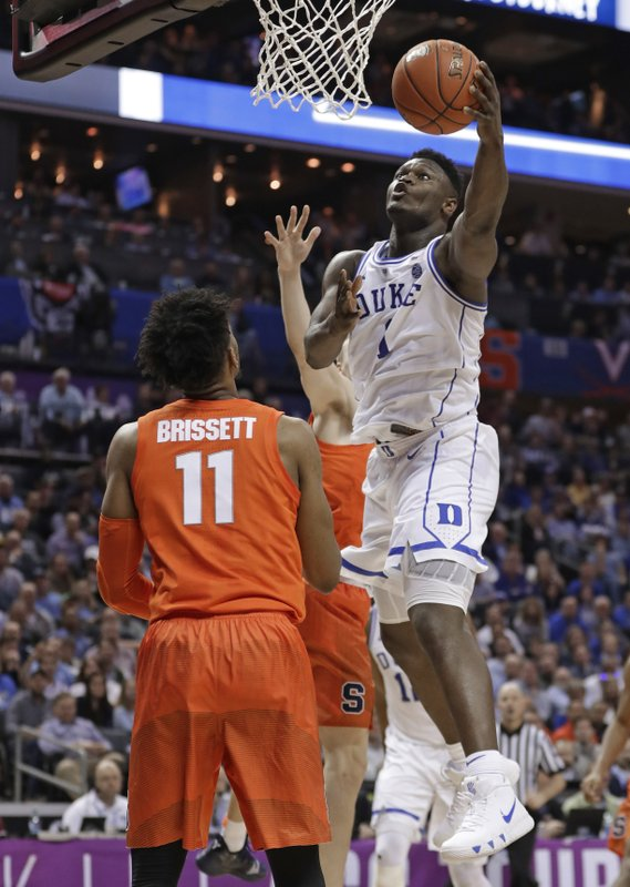 Duke's Zion Williamson (1) drives against Syracuse's Oshae Brissett (11) during the first half of an NCAA college basketball game in the Atlantic Coast Conference tournament in Charlotte, N. (AP Photo/Nell Redmond)
