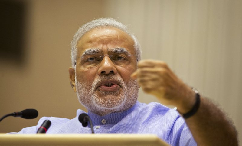 FILE - In this Aug. 28, 2014, file photo, Indian Prime Minister Narendra Modi speaks at the launch of a campaign aimed at opening millions of bank accounts for poor Indians in New Delhi, India. (AP Photo/Saurabh Das, File)