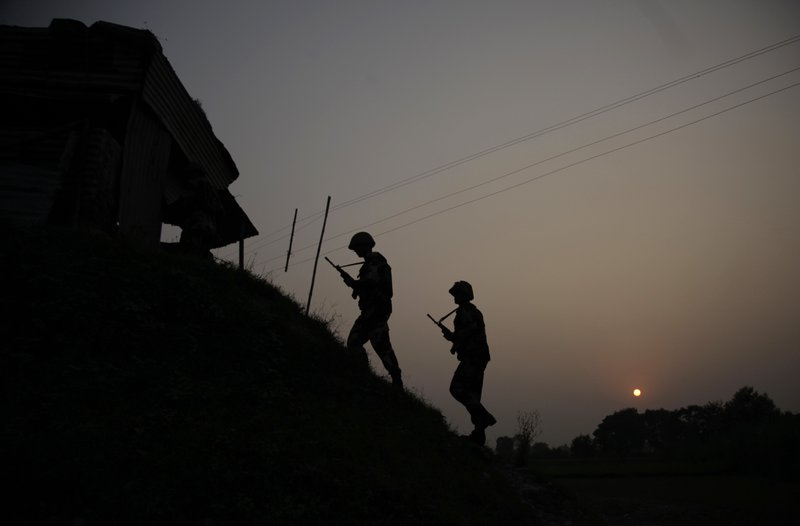 FILE - In this Oct. 1, 2016, file photo, Indian Border Security Force soldiers patrol near the India-Pakistan international border area at Gakhrial boder post in Akhnoor sector, about 48 kilometers from Jammu, India. (AP Photo/Channi Anand, File)