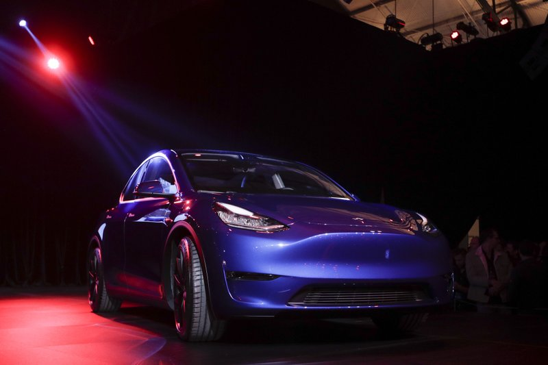 The Tesla Model Y is unveiled at Tesla's design studio Thursday, March 14, 2019, in Hawthorne, Calif. (AP Photo/Jae C. Hong)