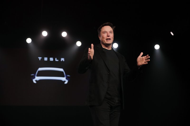 Tesla CEO Elon Musk speaks before unveiling the Model Y at Tesla's design studio Thursday, March 14, 2019, in Hawthorne, Calif. (AP Photo/Jae C. Hong)