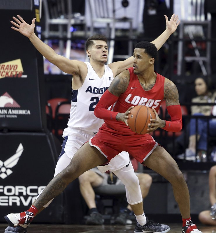 Utah State's Diogo Brito defends against New Mexico's Corey Henson during the first half of an NCAA college basketball game in the Mountain West Conference men's tournament Thursday, March 14, 2019, in Las Vegas. (AP Photo/Isaac Brekken)
