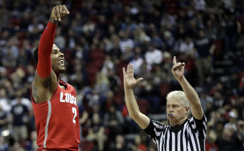 New Mexico's Corey Henson reacts after sinking a 3-point shot during the second half of the team's NCAA college basketball game against Utah State in the Mountain West Conference men's tournament Thursday, March 14, 2019, in Las Vegas. (AP Photo/Isaac Brekken)