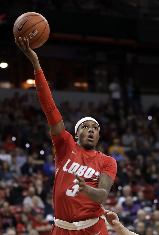 New Mexico's Keith McGee shoots during the second half of the team's NCAA college basketball game against Utah State in the Mountain West Conference men's tournament Thursday, March 14, 2019, in Las Vegas. (AP Photo/Isaac Brekken)