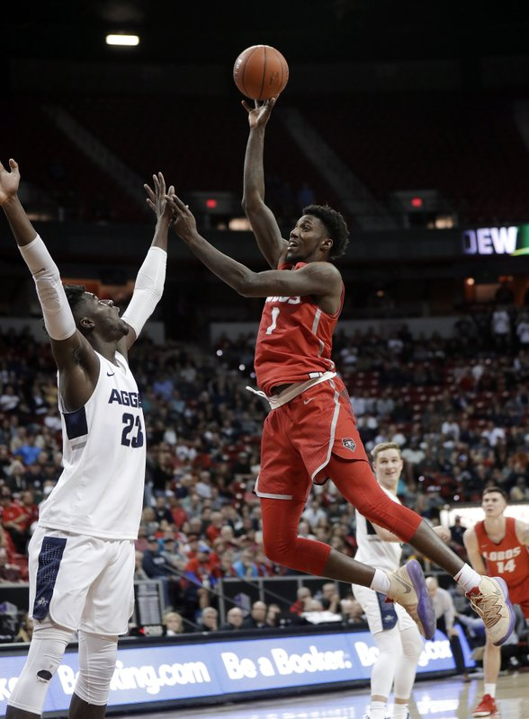 New Mexico's Jalen Harris (1) shoots as Utah State's Neemias Queta defends during the second half of an NCAA college basketball game in the Mountain West Conference men's tournament Thursday, March 14, 2019, in Las Vegas. (AP Photo/Isaac Brekken)