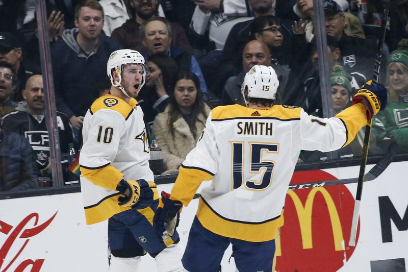 Nashville Predators forward Colton Sissons (10) celebrates his goal with Craig Smith (15) during the second period of an NHL hockey game against Los Angeles Kings on Thursday, March 14, 2019, in Los Angeles. (AP Photo/Ringo H.W. Chiu)