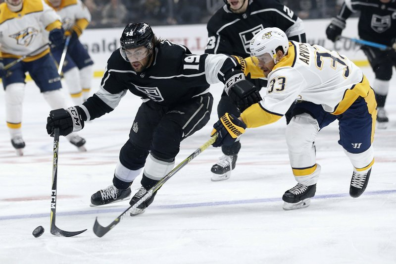 Los Angeles Kings forward Alex Iafallo (19) and Nashville Predators forward Viktor Arvidsson (33) vie for the puck during the second period of an NHL hockey game Thursday, March 14, 2019, in Los Angeles. (AP Photo/Ringo H.W. Chiu)
