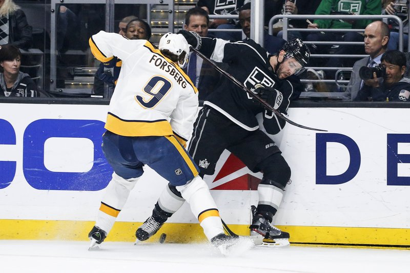 Nashville Predators forward Filip Forsberg (9) and Los Angeles Kings defenseman Alec Martinez (27) vie for the puck during the first period of an NHL hockey game Thursday, March 14, 2019, in Los Angeles. (AP Photo/Ringo H.W. Chiu)
