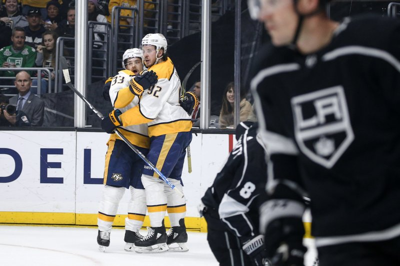 Nashville Predators forward Viktor Arvidsson (33) celebrates his goal with teammate Ryan Johansen (92) during the first period of an NHL hockey game against Los Angeles Kings on Thursday, March 14, 2019, in Los Angeles. (AP Photo/Ringo H.W. Chiu)