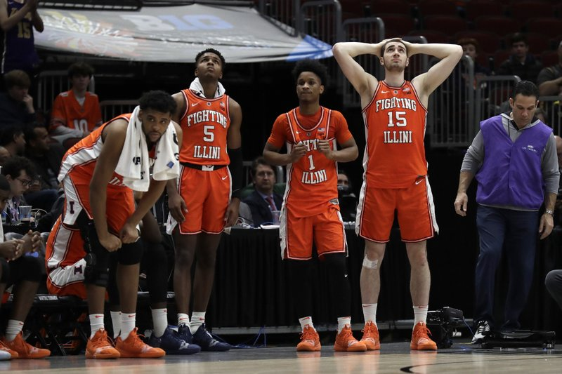 Illinois's Adonis De La Rosa (12), Tevian Jones (5), Trent Frazier (1) and Giorgi Bezhanishvili (15) react on the bench during the second half of an NCAA college basketball game against the Iowa in the second round of the Big Ten Conference tournament, Thursday, March 14, 2019, in Chicago. (AP Photo/Nam Y. Huh)
