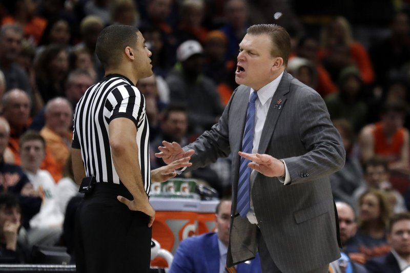 Illinois head coach Brad Underwood argues a call during the second half of an NCAA college basketball game against the Iowa in the second round of the Big Ten Conference tournament, Thursday, March 14, 2019, in Chicago. (AP Photo/Nam Y. Huh)