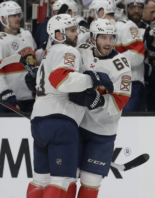 Florida Panthers left wing Mike Hoffman, right, celebrates with Keith Yandle after scoring a goal against the San Jose Sharks during the second period of an NHL hockey game in San Jose, Calif. (AP Photo/Jeff Chiu)