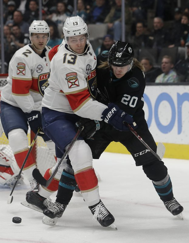 San Jose Sharks left wing Marcus Sorensen (20) reaches for the puck against Florida Panthers defenseman Mark Pysyk (13) during the first period of an NHL hockey game in San Jose, Calif. (AP Photo/Jeff Chiu)