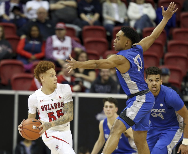 Fresno State's Noah Blackwell (55) looks to pass the ball as Air Force's AJ Walker (10) defends during the first half of an NCAA college basketball game in the Mountain West Conference men's tournament Thursday, March 14, 2019, in Las Vegas. (AP Photo/Isaac Brekken)