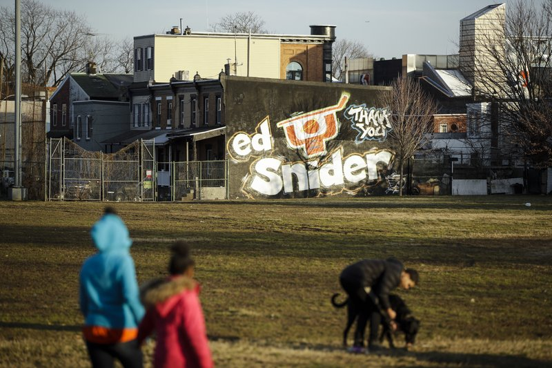 In this Feb. 21, 2019 photo a mural dedicated to Ed Snider is seen on the side of a home near the Scanlon Ice Rink in Philadelphia. (AP Photo/Matt Rourke)
