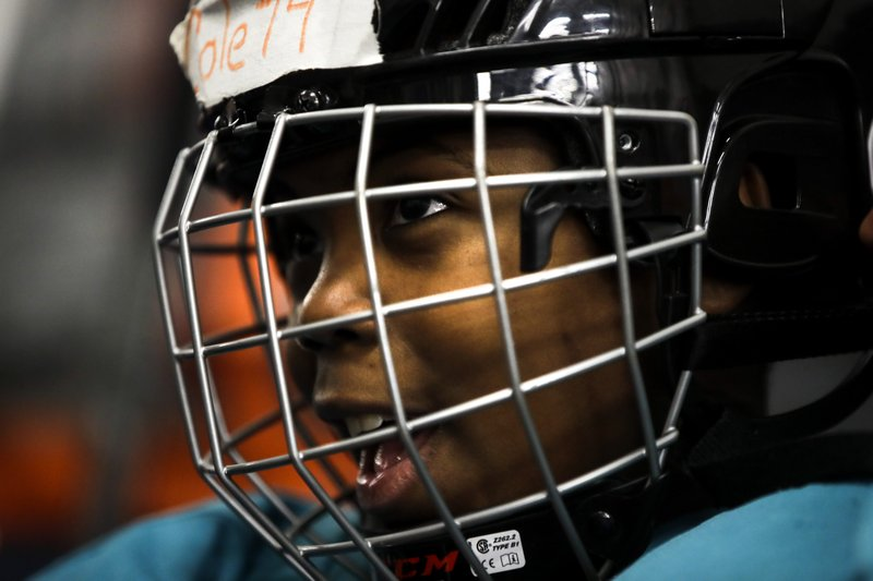 In this Feb. 21, 2019 photo Malakye Johnson prepares for a Snider Hockey practice at the Scanlon Ice Rink in Philadelphia. (AP Photo/Matt Rourke)