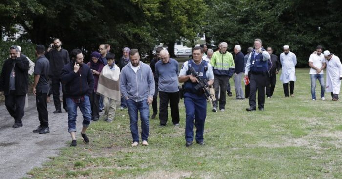 Police escort witnesses away from a mosque in central Christchurch, New Zealand, Friday, March 15, 2019. (AP Photo/Mark Baker)