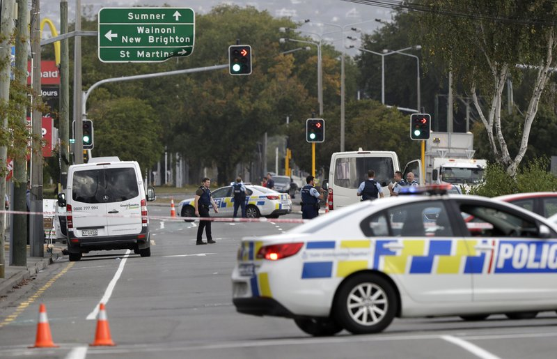 Police block the road near the shooting at a mosque in Linwood, Christchurch, New Zealand, Friday, March 15, 2019. (AP Photo/Mark Baker)