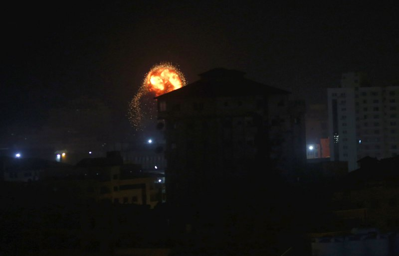 An explosion caused by Israeli airstrikes is seen on Gaza City, early Friday, Friday, March 15, 2019. (AP Photo/Adel Hana)