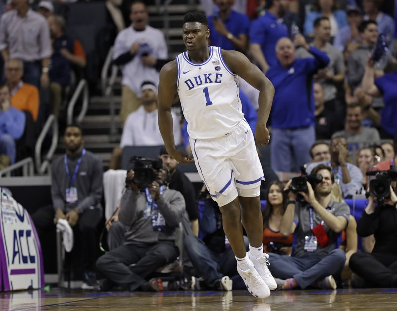 Duke's Zion Williamson (1) reacts after a dunk against Syracuse during the first half of an NCAA college basketball game in the Atlantic Coast Conference tournament in Charlotte, N. (AP Photo/Chuck Burton)