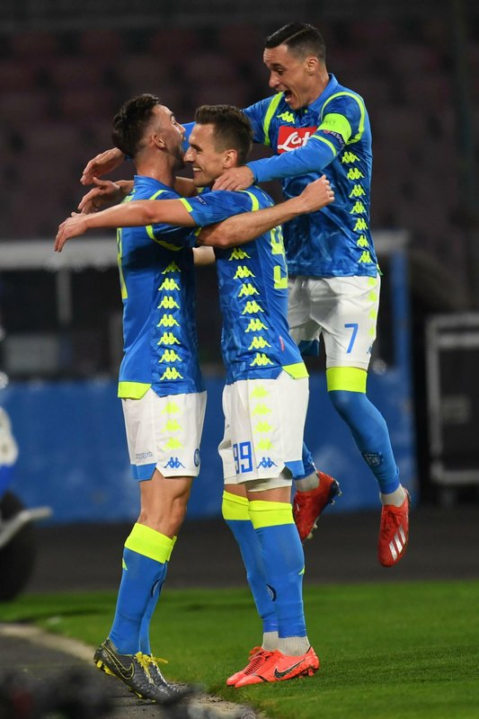 Napoli's midfielder Fabian Ruiz, left, celebrates scoring with his teammates during the Europa League round of 16 first leg soccer match between SSC Napoli and FC Salzburg at San Paolo stadium in Naples, Italy, Thursday March 7, 2019. (Ciro Fusco/ANSA via AP)