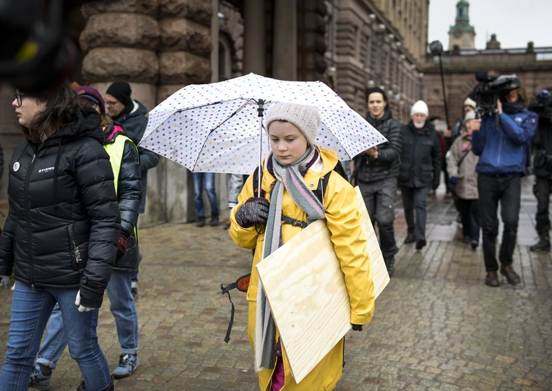 Activist Greta Thunberg, foreground, participates in a climate protest, in central Stockholm Sweden, Friday, March 15, 2019. (Pontus Lundahl/TT News Agency via AP)