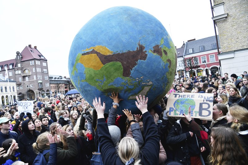 Students participate in a climate protest, at Stortorget in Lund, Sweden, Friday, March 15, 2019. Students worldwide skipped classes Friday to take to the streets to protest their governments' failure to take sufficient action against global warming. (Johan Nilsson /TT News Agency via AP)