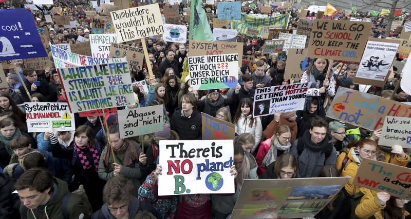 Students attend a protest ralley of the 'Friday For Future Movement' in Berlin, Germany, Friday, March 15, 2019. (AP Photo/Michael Sohn)