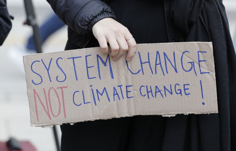 A participant holds a sign during a rally for global climate strike for future in Seoul, South Korea, Friday, March 15, 2019. (AP Photo/Lee Jin-man)