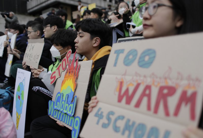 Students hold signs during a rally for global climate strike for future in Seoul, South Korea, Friday, March 15, 2019. (AP Photo/Lee Jin-man)