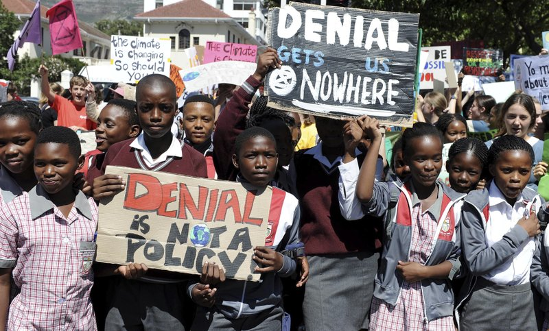 Students in Cape Town, South Africa take part in a protest, Friday, March 15, 2019 as part of a global student strike against government inaction on climate change. (AP Photo/Nasief Manie)