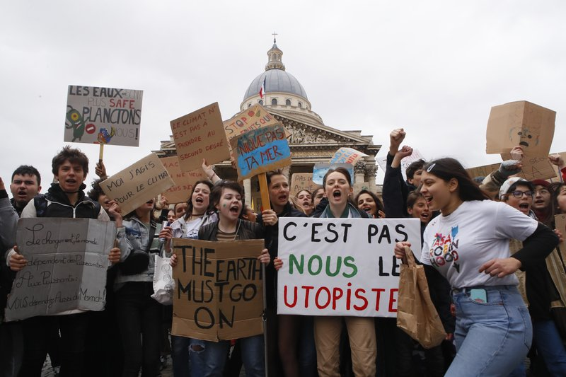High school students demonstrate outside the Pantheon monument in Paris, Friday, March 15, 2019. Students worldwide are skipping class Friday to take to the streets to protest their governments' failure to take sufficient action against global warming. (AP Photo/Francois Mori)