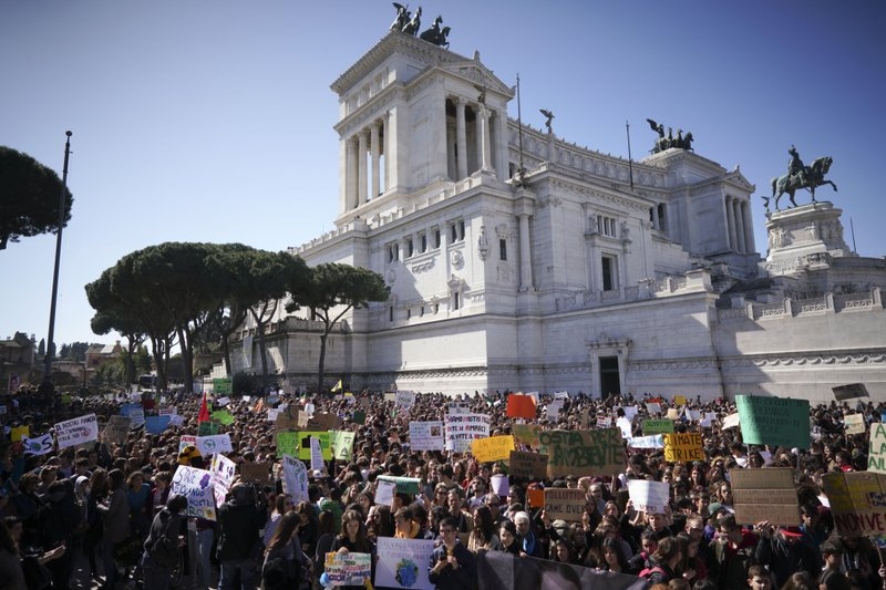 Students gather in front of the monument of the Unknown Soldier to demand action on climate change, in Rome, Friday, March 15, 2019. (AP Photo/Andrew Medichini)