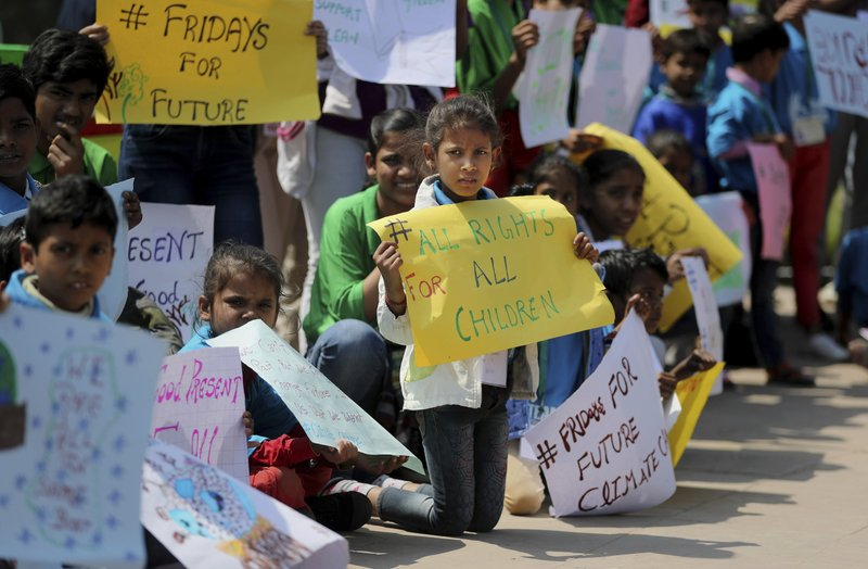 Students from different institutions hold placards and banners as they participate in a climate protest in New Delhi, India, Friday, March 15, 2019. (AP Photo/Altaf Qadri)