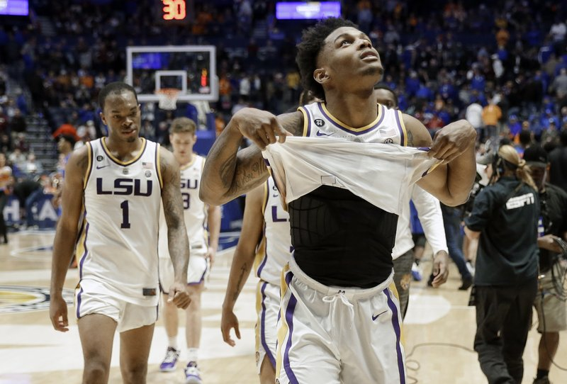 LSU guard Marlon Taylor, right, and guard Javonte Smart (1) walk off the court after losing to Florida in an NCAA college basketball game at the Southeastern Conference tournament Friday, March 15, 2019, in Nashville, Tenn. (AP Photo/Mark Humphrey)