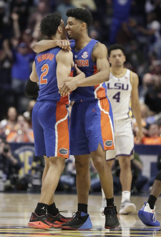 Florida guard Andrew Nembhard (2) is hugged by Jalen Hudson after Nembhard hit the winning 3-point basket against LSU in the second half of an NCAA college basketball game at the Southeastern Conference tournament Friday, March 15, 2019, in Nashville, Tenn. (4). (AP Photo/Mark Humphrey)