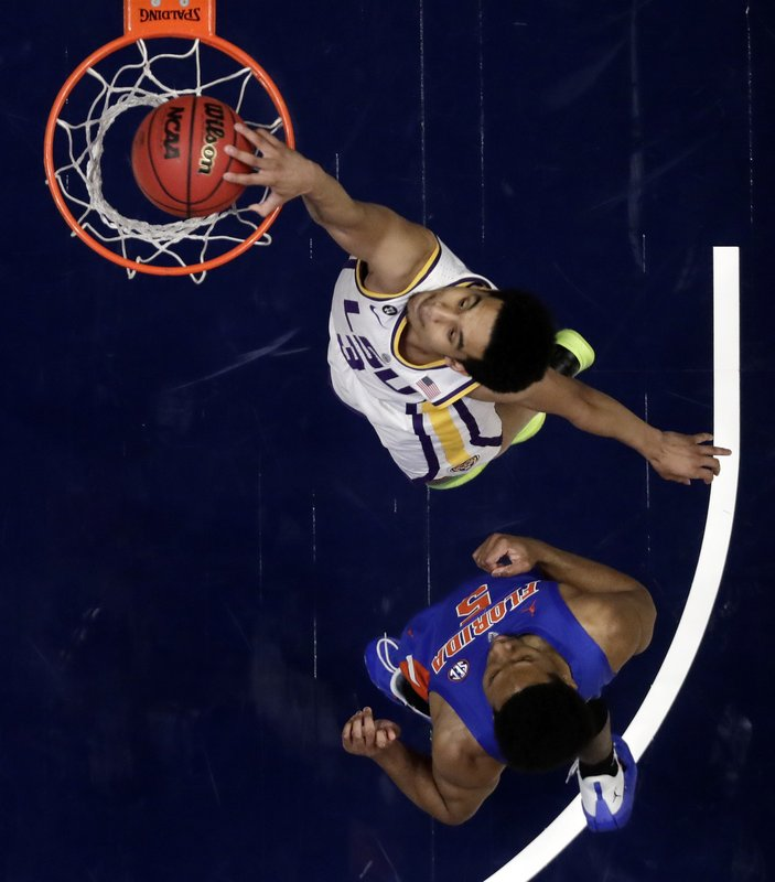 LSU guard Tremont Waters (3) dunks the ball ahead of Florida guard KeVaughn Allen (5) in the first half of an NCAA college basketball game at the Southeastern Conference tournament Friday, March 15, 2019, in Nashville, Tenn. (AP Photo/Mark Humphrey)