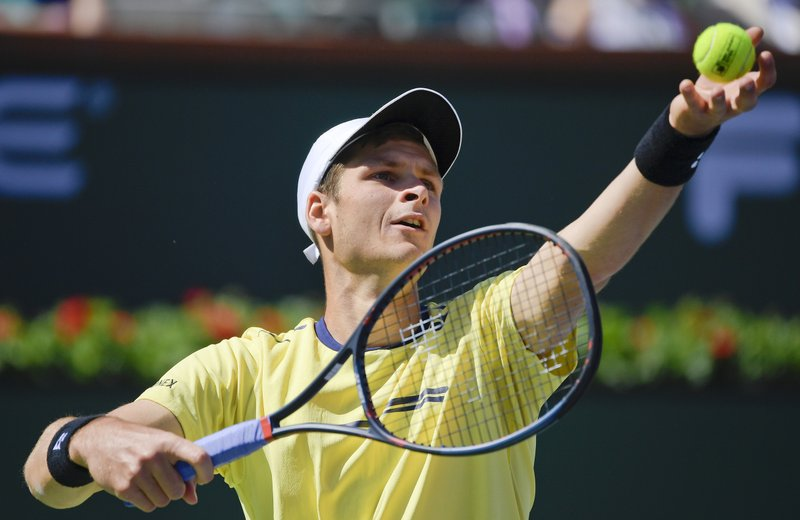 Hubert Hurkacz, of Poland, serves to Roger Federer, of Switzerland, at the BNP Paribas Open tennis tournament Friday, March 15, 2019, in Indian Wells, Calif. (AP Photo/Mark J. Terrill)