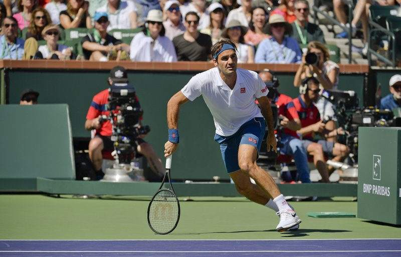 Roger Federer, of Switzerland, chases a ball against Hubert Hurkacz, of Poland at the BNP Paribas Open tennis tournament Friday, March 15, 2019, in Indian Wells, Calif. (AP Photo/Mark J. Terrill)
