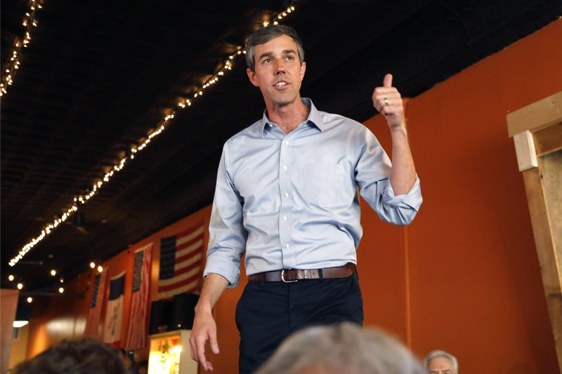 Former Texas congressman Beto O'Rourke speaks to local residents during a stop at the Central Park Coffee Company, Friday, March 15, 2019, in Mount Pleasant, Iowa. (AP Photo/Charlie Neibergall)