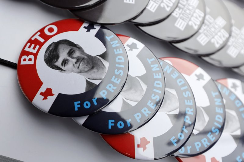 Buttons for former Texas congressman Beto O'Rourke sit on display during a stop at the Central Park Coffee Company, Friday, March 15, 2019, in Mount Pleasant, Iowa. (AP Photo/Charlie Neibergall)