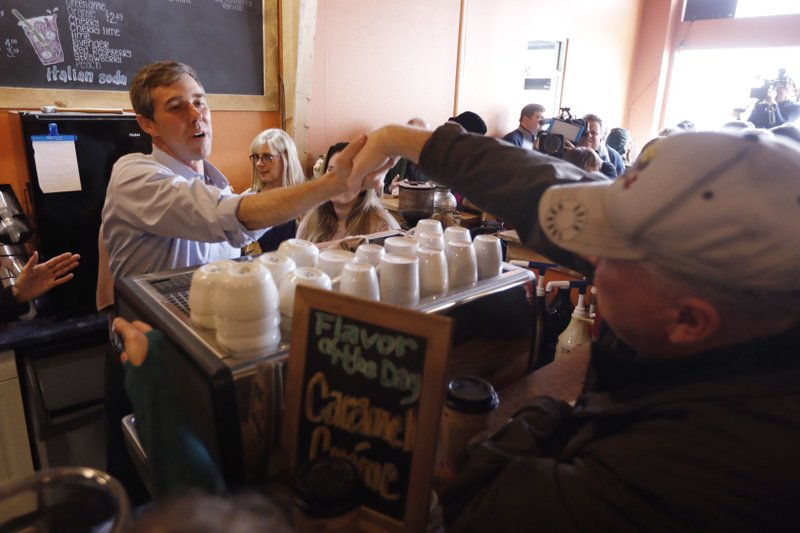 Former Texas congressman Beto O'Rourke greets an audience member during a stop at the Central Park Coffee Company, Friday, March 15, 2019, in Mount Pleasant, Iowa. (AP Photo/Charlie Neibergall)